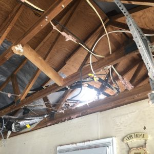 Inside Home Ceiling and Rafter Damage IMG_6672